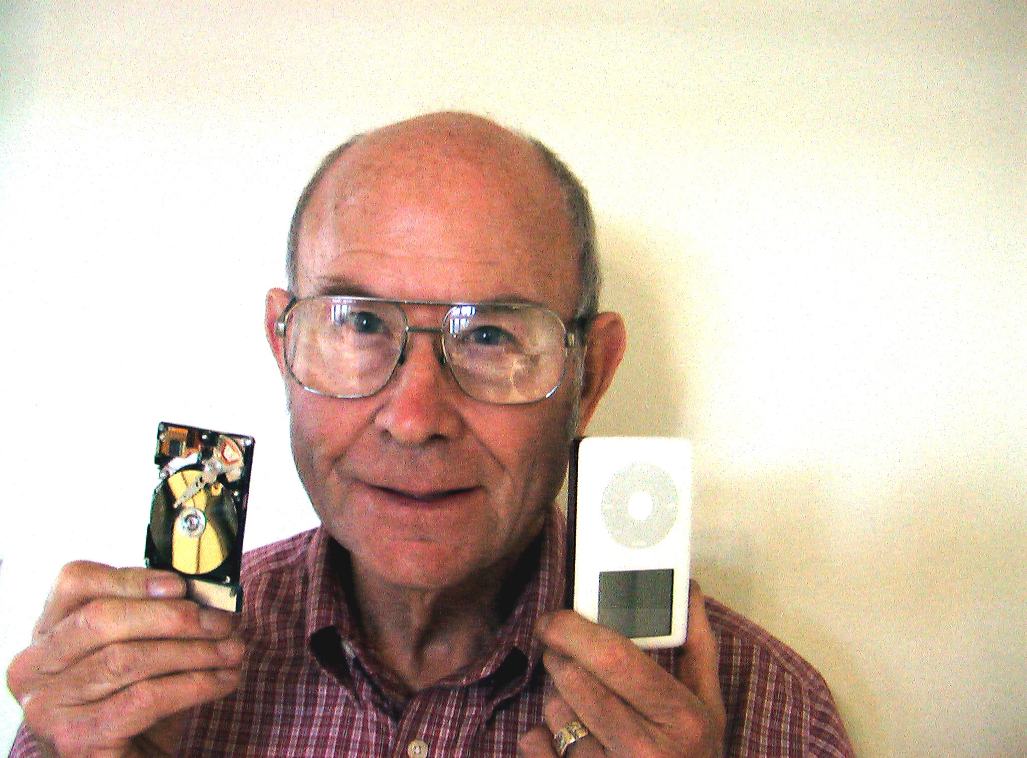 Author holding an iPod hard drive.